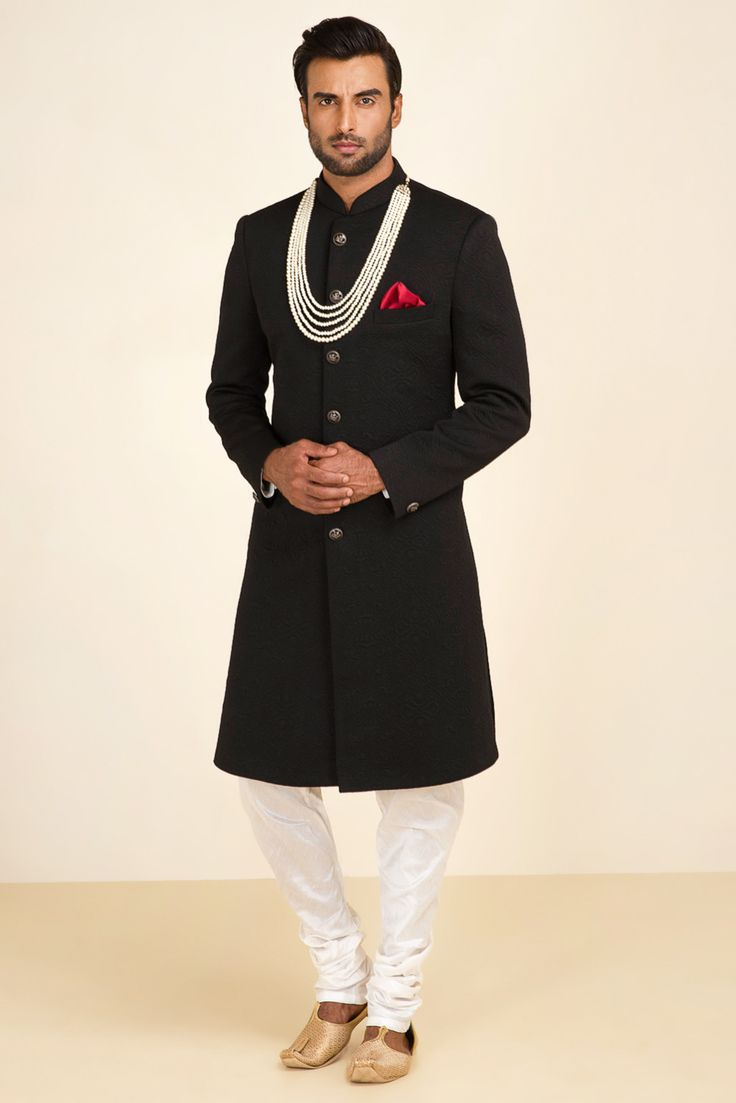 EKAKSH black textured achkan with ivory churidaar