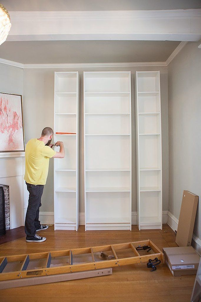 For Master Bedroom?/ With tasteful crown molding and a sliding library ladder, this sleek built-in has all the tell-tale signs of a big-budget project, except for the steep price tag; it's made up of three Ikea Billy bookca...