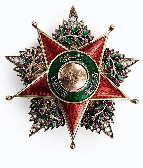 "Late-Ottoman Order of Charity (Nişan-ı Şefkat).  Instituted in 1878 by ""Sultan Abdulhamid II"" in three classes, this order was reserved for women. – First Class Star (diamonds, rubies, gold, enamels, 75mm)."