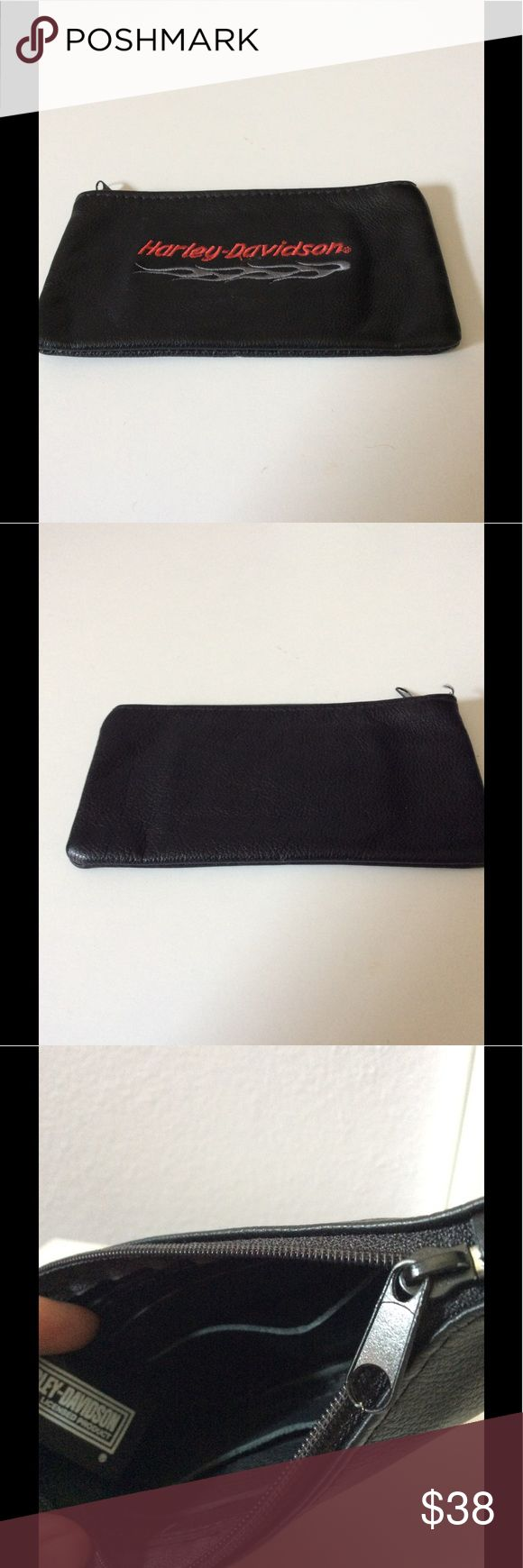 Harley Davidson Wallet Harley Davidson leather wallet with zipper closure...it has a few cards slots inside....in very good condition...no rips or teas. Harley-Davidson Bags Wallets