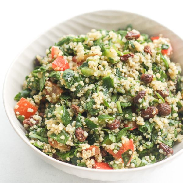 Quinoa Spinach Power Salad with Lemon Vinaigrette: Take a bite into this refreshing, gluten-free quinoa and spinach salad bursting with colourful tomatoes, cucumbers and raisins   aheadofthyme.com