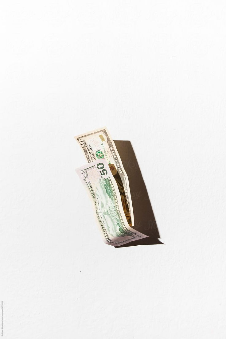 Dollar Bills Falling Against A White Wall. | Stock…