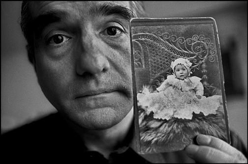 USA. New York City. Manhattan. 1990.  The Sicilian film director Martin SCORSESE at home, with a photograph of his mother as a child. - by Ferdinando Scianna