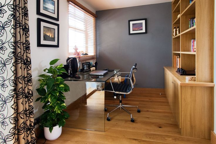 Study area/work nook with oak bookcases and storage