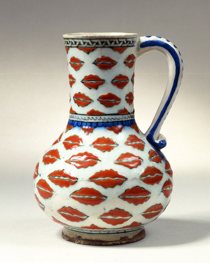 Fritware jug, painted in black and blue and with a red slip under a transparent glaze  Turkey, Iznik; c. 1575  H: 21 cm