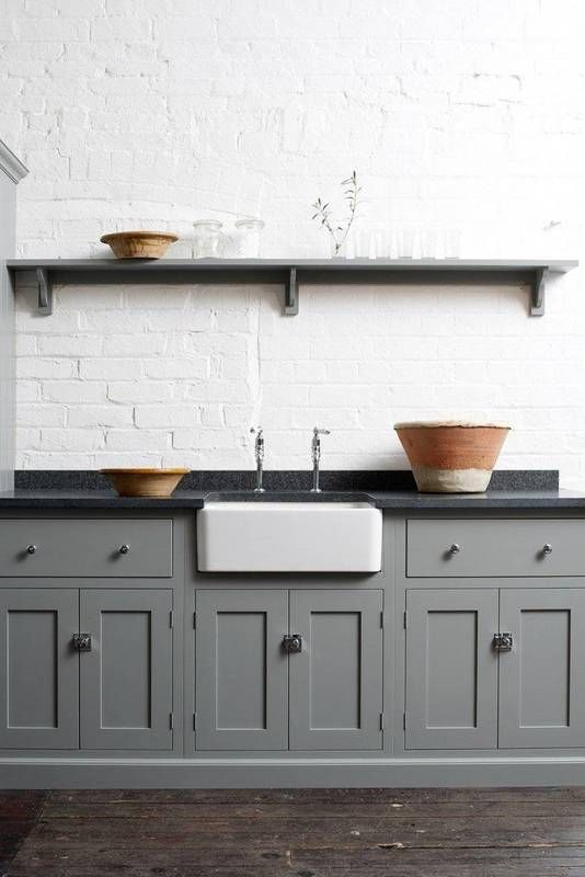 What could pass as concrete or granite is actually black soapstone - a natural material that has a milkier color than ultra-sleek granite or marble. Consider soapstone if you're craving a rustic addition to your kitchen that's low-maintenance and resistant to staining.