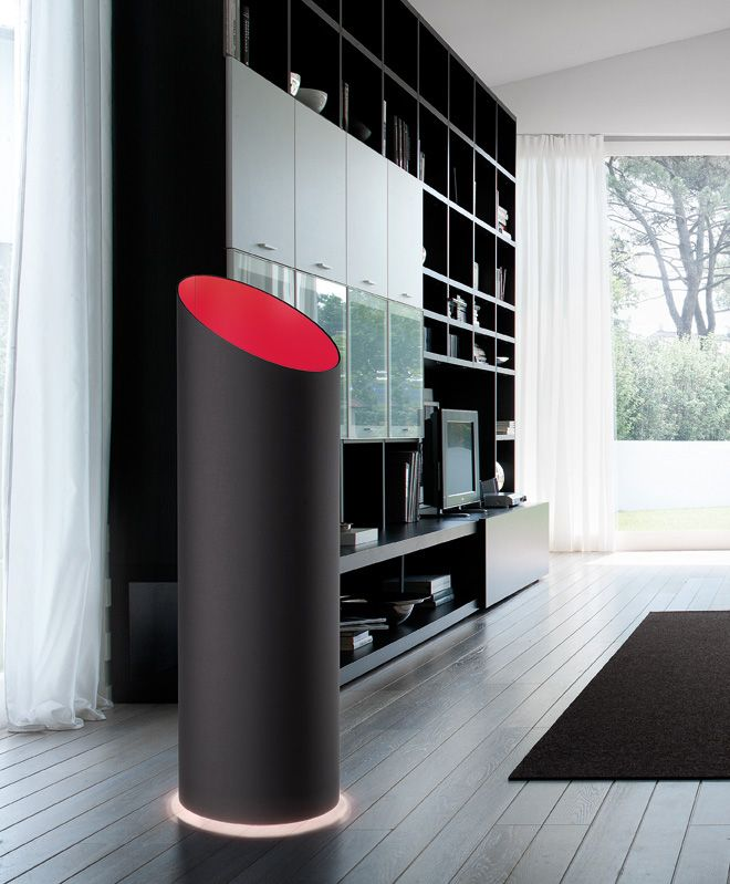 Pank TE floor lamp in black covering fabric with red fabric inside.