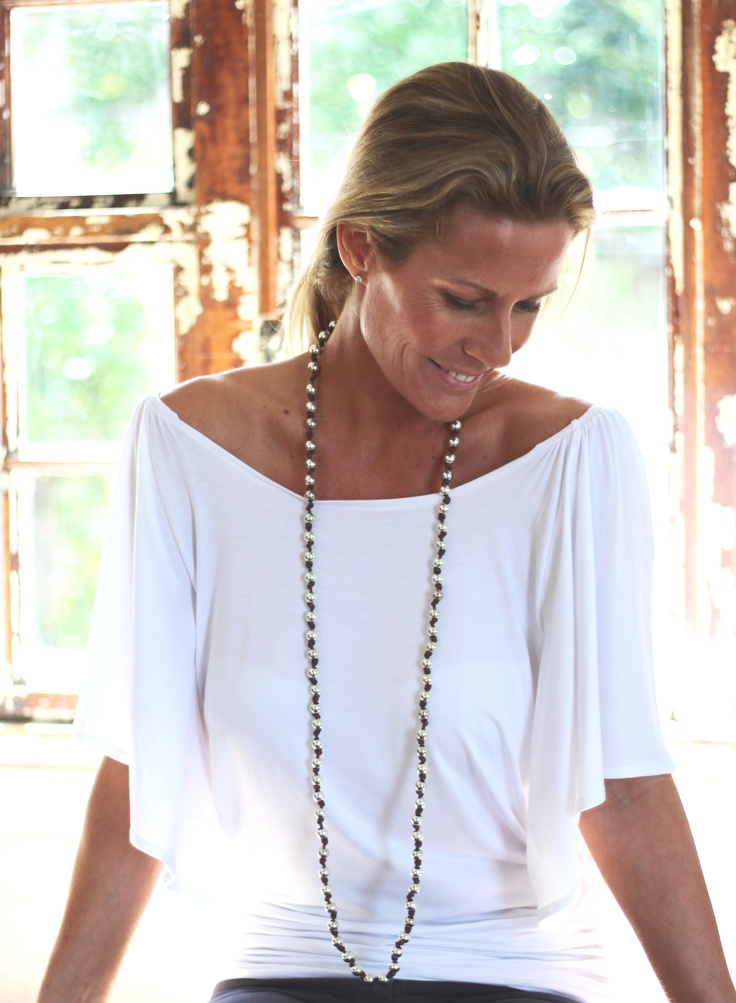 the 'petal top' ... this falls beautifully! it has a gorgeous neckline, the petal sleeves are cool and fall gently down the arm which eccentuates true femininety. This top can be worn comfortably with both slax, skirts or shorts. I think this top would look unbelievable paired with some bermuda's and sexy wedges! x x x