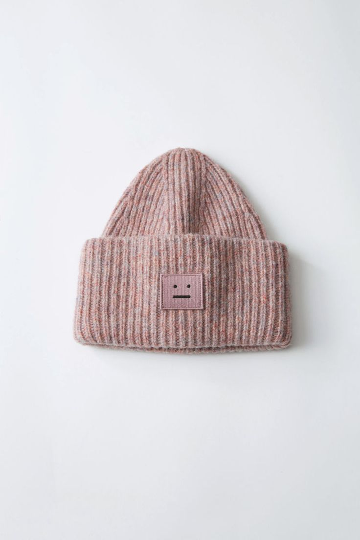 f7c25b53ae3 Acne Studios Pansy Wool dusty pink is a street style inspired ribbed beanie  hat.