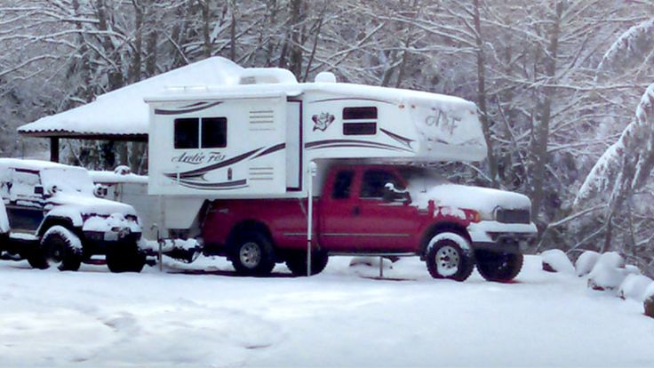 Cold weather camping in an Arctic Fox Camper, http://www.truckcampermagazine.com/question-of-the-week/100-winter-truck-camping-tips/