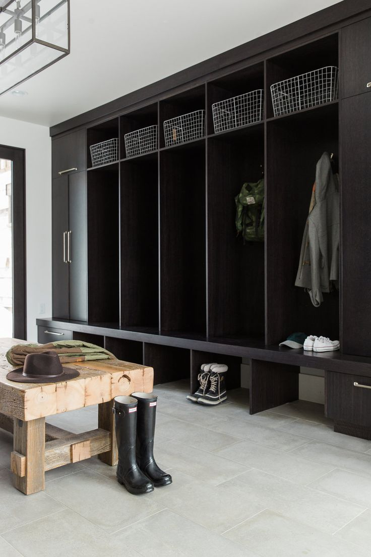 open cubbies and open bottom, baskets on top. one cabinet at the end of each side. rustic bench in middle