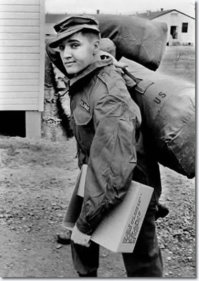 Elvis Presley in his military gear at Ft. Chaffee, Ark., March 1958