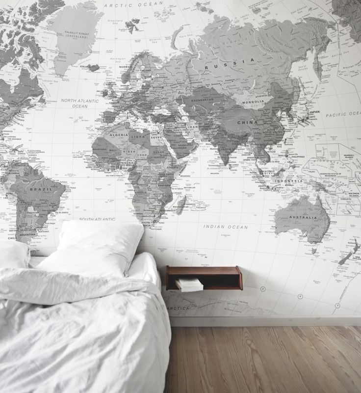 This black and white map wallpaper gives a clean aesthetic to this stylish bedroom.