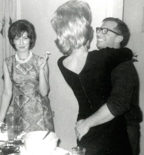 1960s party photo - You know what the guy is thinking, but what is the gal on the left thinking?