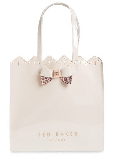 belacon large icon tote by Ted Baker. Slightly shimmery, scalloped and set off with a signature, glittery bow, this spacious tote is a perfect around-town companion.  #tedbaker #bags