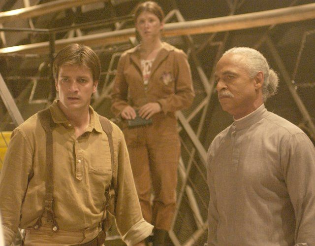 Still of Nathan Fillion, Ron Glass and Jewel Staite in Firefly (2002)Captain Malcolm 'Mal' Reynolds, Kaylee Frye, Shepherd Derrial Book