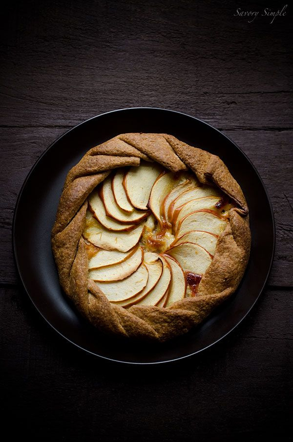 This cheesy apple, cheddar and caramelized onion galette has a flaky whole wheat crust and tons of flavor. It's a perfect, light appetizer.