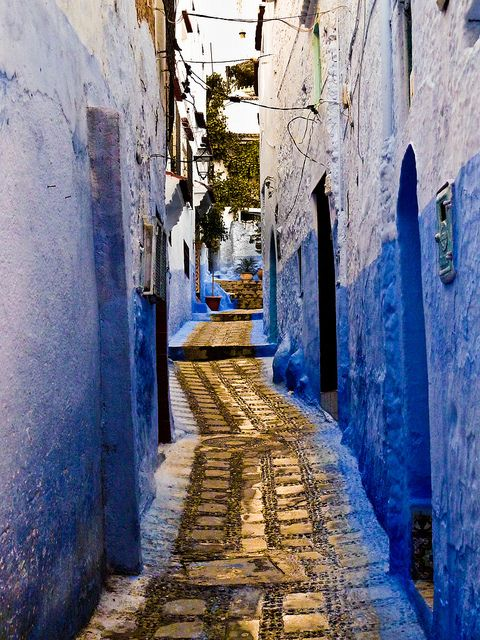 Blue stucco and a golden stone alley in Chefchaouen, Morocco….heavenly!