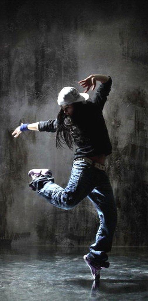 Modern style dancer posing behind studio background by Alexander Yakovlev