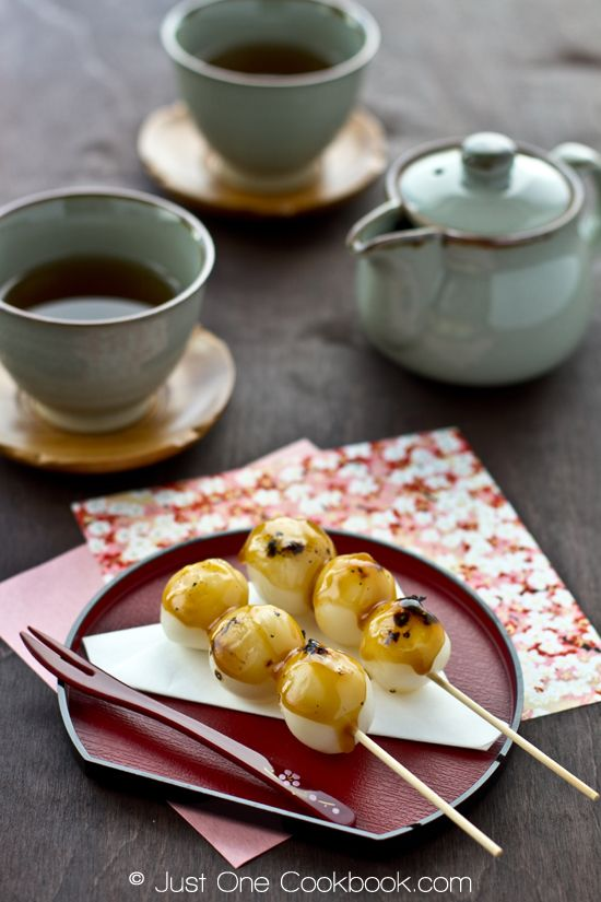 Mitarashi Dango: warm, soft, grilled mochi ball covered in a sweet soy sauce, a traditional Japanese sweet