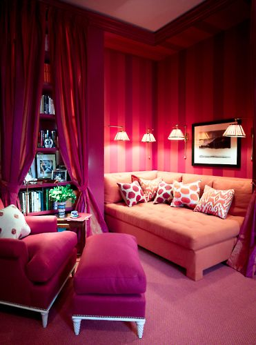 Stunning den!! Crazy about the draped bookcase! Love the fushia and coral.