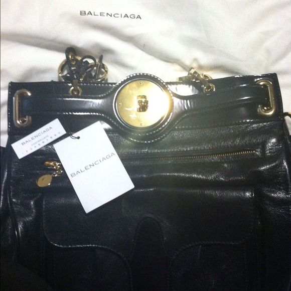 ****REDUCED**** Balenciaga Bag This is an authentic Balenciaga Bag. very stylish if you like big bags. It's only been used once or twice at most and is in great condition. I just never got around to wearing that much with work and school so I'm selling it to pay for school : ) Balenciaga Bags