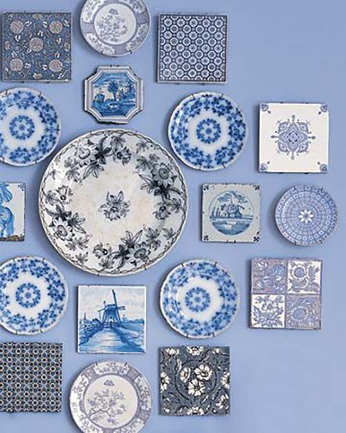 A collection of beautiful Delftware plates and coasters via Shelterness.