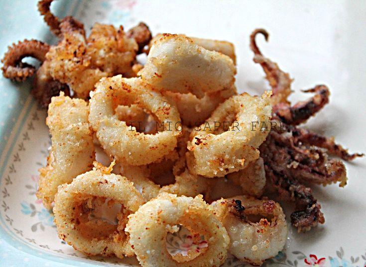 Anelli di calamari fritti aromatizzati all'arancia
