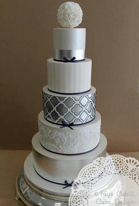 Silver and White Fondant Cake with Various Elements.  Faye Cahill Cake Design