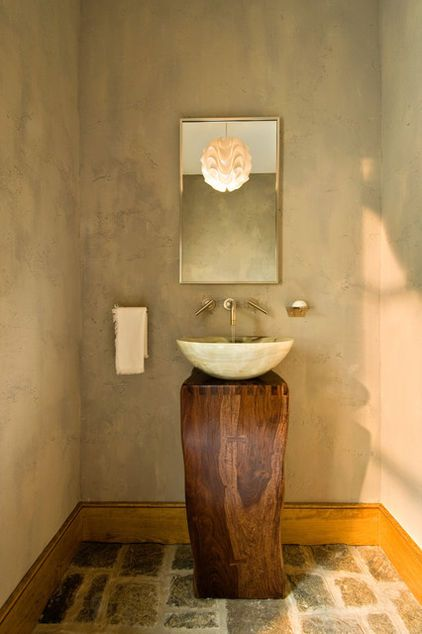 Here is a simple and beautiful pedestal that you can buy ready made. Stone Forest creates these lovely pieces. This vanity area has a very minimalist aesthetic that is complemented by the simple mirror and stonelike walls created with plaster and paint.