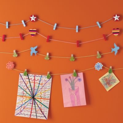Love these hanging wall clips to hang the kid's artwork