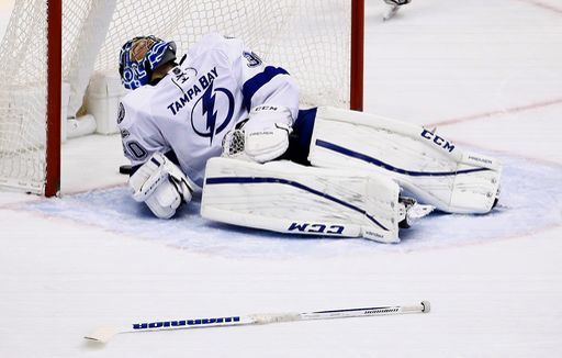 Tampa Bay Lightning goalie Ben Bishop stays on the ice after giving up a goal to Arizona Coyotes defenseman Michael Stone during the second period of an NHL hockey game Saturday, Jan. 21, 2017, in Glendale, Ariz. (AP Photo/Ross D. Franklin)
