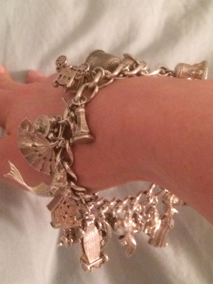 #vintage #silver #charm #bracelet #1960s sorry about the weird angle and position my wrist is in! #windmill #coach #clock #car #fan #fish #shoe #elephant #pixie #bell #thimble #hat #lady #vintageprettythings #vintagelove #recycle #eco #recycledglamour