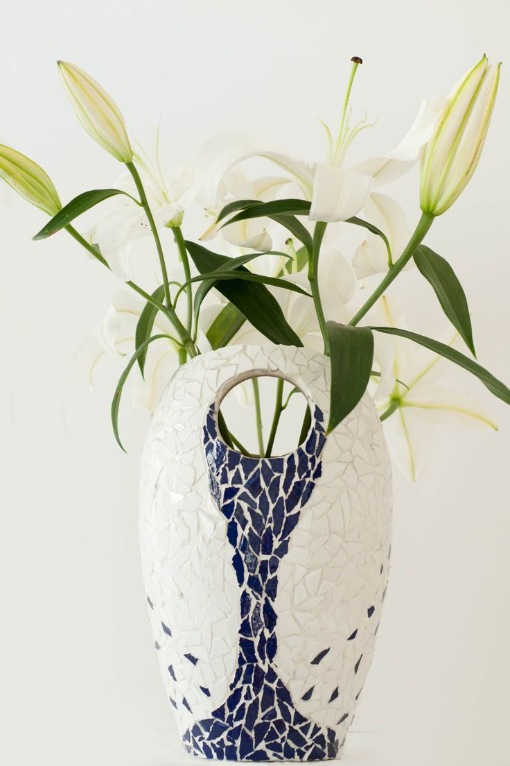 I wanted to capture the perception that the water within the vase was overflowing and spraying up onto the vase.  For Sale - see Etsy 'Love and Pieces Mosaics'