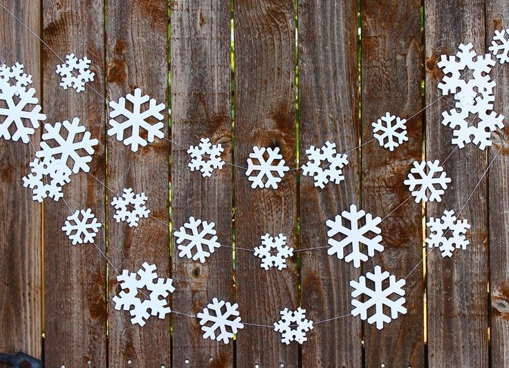 Snowflake Paper Garland, Photo Prop, Holiday Decor, Winter Snowflake Decor, Snowflake Banner, Holiday Garland, Winter Home Decor by MailboxHappiness on Etsy https://www.etsy.com/listing/210728479/snowflake-paper-garland-photo-prop