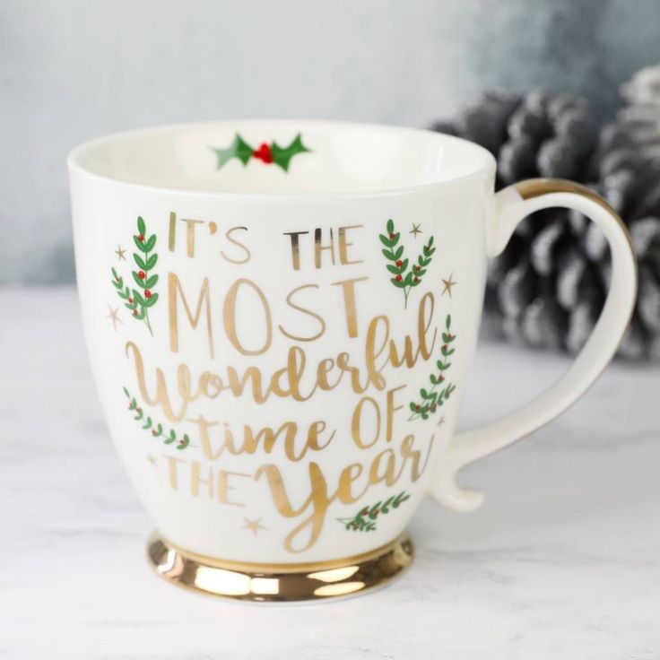 This festive mug is the perfect piece of kitchenware to add some Christmas spirit! Made from white ceramic with 'the most wonderful time of the year' printed on both sides in metallic gold cursive lettering, surrounded by mistletoe illustrations and shiny gold stars. This mug comes in a gorgeous presentation box, making it the perfect dining accessory to give as a gift! #christmasgift #christmas #christmasdecor affiliatelink