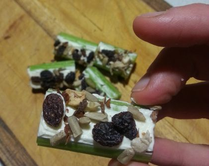 C for Celery with Cream Cheese, sultanas and sunflower seeds