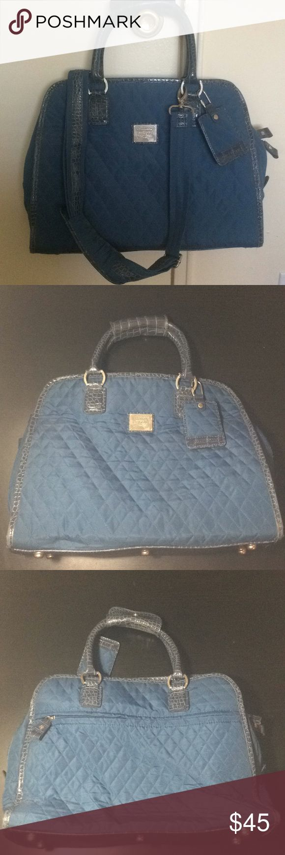 Quilted  Liz Claiborne Laptop Carry On Quilted Blue Liz Claiborne Laptop Case/Carry On with Faux Snakeskin Details Comes with removable shoulder strap and luggage tag. Inside has a padded sleeve for a Laptop, and room for books, files, etc. 3 interior pockets, one with zipper 2 open outside compartments, and one zippered Excellent Condition.  Great for business travel and very stylish, I got compliments all the time! Liz Claiborne Bags Laptop Bags