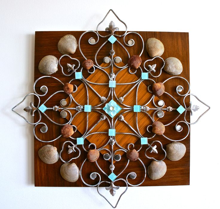 hand made wall decoration, by using recycled material & nature elements.
