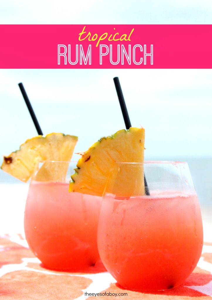 Tropical Rum Punch drink recipe - perfect for Summer weekends! 1 part Mango Rum, 1 part Red Rum, 1.5 ounces cranberry juice, 1.5 parts orange juice, 1.5 parts pineapple juice, splash of Triple Sec.