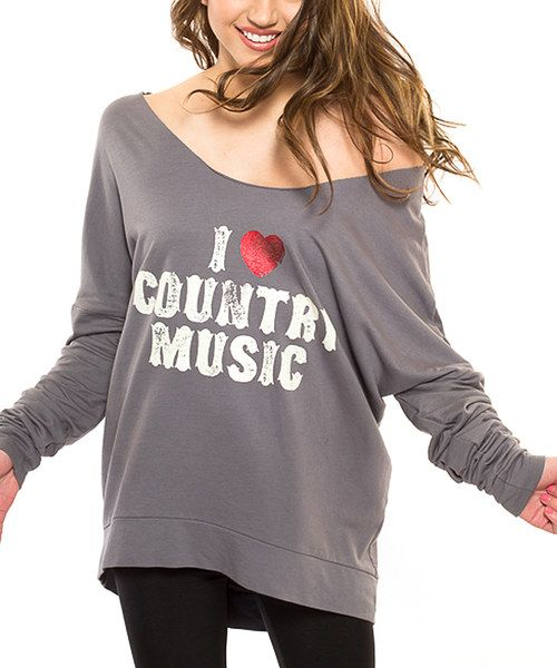 No closet collection is complete without its classic staples. With its ''I Love Country Music'' graphic and off-the-shoulder silhouette, this tee will become any southern girl's favorite. 50% supima / 50% modalMachine wash; tumble dryMade in the USA