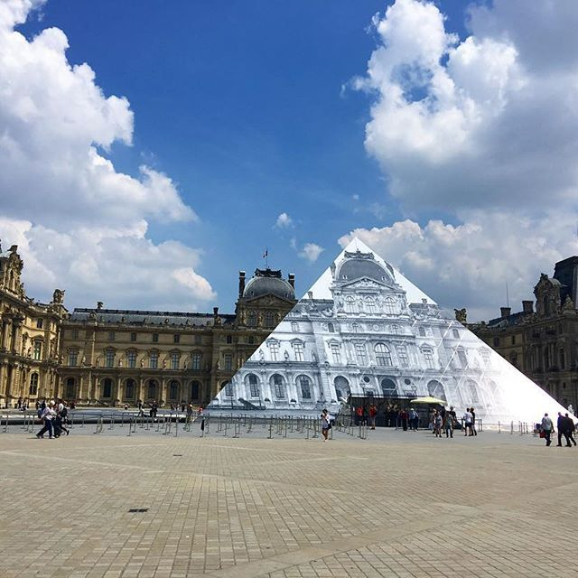 Sorry! A little late...@JR installation on the pyramids of the Louvre #💕. ............  .  .  .  .   #paris #louvre #france #jr #art #installation #sculpture #pyramids #weddings #bridal #travel    #Regram via @elika.in.love