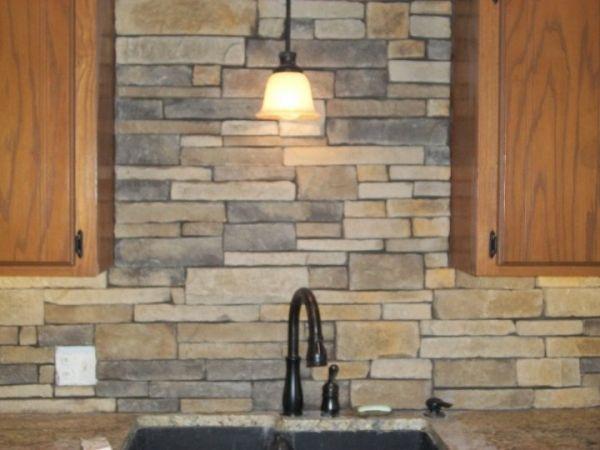 stone backsplash for kitchen (might look nice with the warm pine cabinets?)  Carmel Ridge Drystack- Backsplash