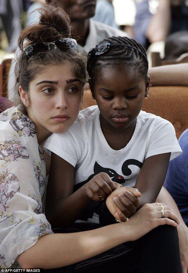 Madonna's daughter Lourdes cradled her little sister Mercy
