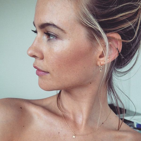 Behati Prinsloo - Behati's dainty forward-helix piercing completes the bling collection on her lobe. Make like the Victoria's Secret model and experiment with an assortment of charm and hoop jewelry.Photo: @bee_prinsloo