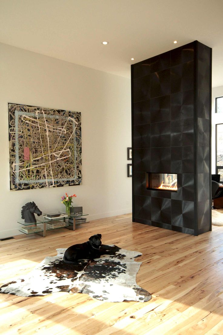 Extravagant fireplace steals the show stone fireplace for the spacious - A Bold Black Fireplace Surround Compliments The Sophisticated Ribbons Of Flame From Our Direct Vent Vu