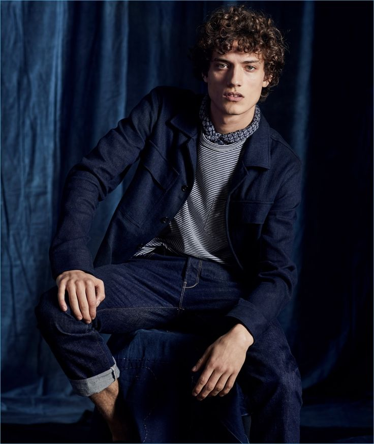 Todd Snyder highlights its linen cotton herringbone shirt jacket in navy. Here, Serge Rigvava wears it with the brand's striped pocket tee and indigo rinse jeans.