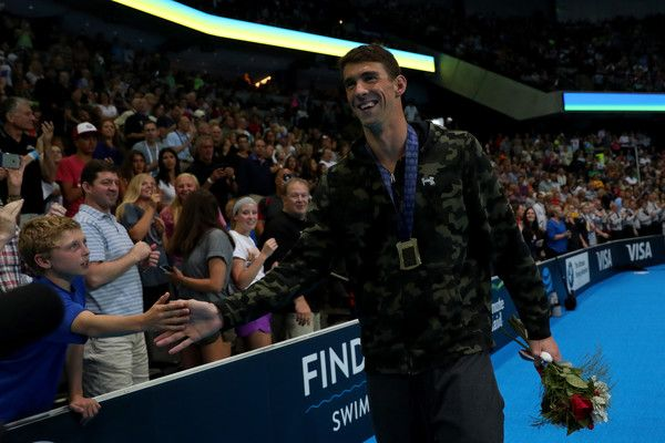 Michael Phelps Photos Photos - Michael Phelps of the United States participates in the medal ceremony for the Men's 100 Meter Butterfly during Day Seven of the 2016 U.S. Olympic Team Swimming Trials at CenturyLink Center on July 2, 2016 in Omaha, Nebraska. - 2016 U.S. Olympic Team Swimming Trials - Day 7