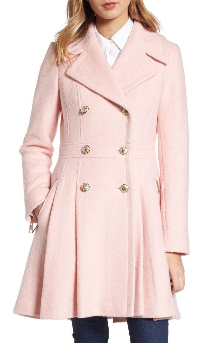Gleaming goldtone buttons add military polish to this warm felted coat tailored in a waist-whittling silhouette with a feminine flared skirt.