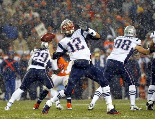 New England Patriots quarterback Tom Brady (12) throws against the Denver Broncos during the first half of an NFL football game, Sunday, Nov. 29, 2015, in Denver. (AP Photo/Jack Dempsey)